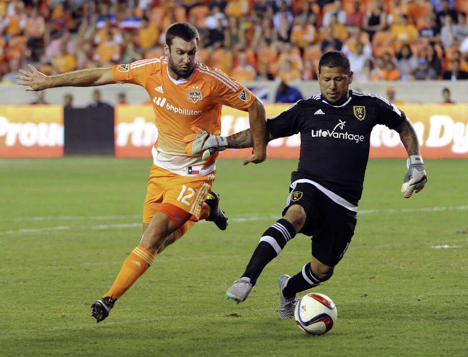 Dynamo forward Will Bruin (12) pursues Real Salt Lake goalkeeper Nick Rimando, right, who might be a little out of his element dribbling the ball. Photo: Eric Christian Smith, FRE / FR171023 AP