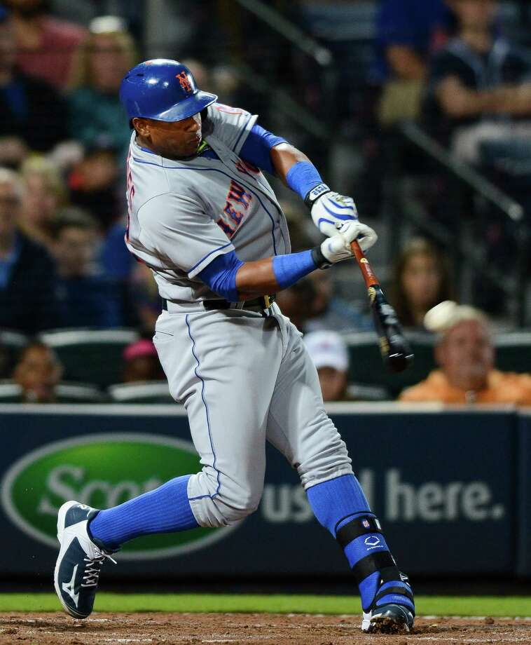 New York Mets center fielder Yoenis Cespedes hits a solo home run during the eighth inning of a baseball game against the Atlanta Braves, Saturday, Sept. 12, 2015, in Atlanta. (AP Photo/Jon Barash) ORG XMIT: GAJB307 Photo: Jon Barash / FR171294 AP