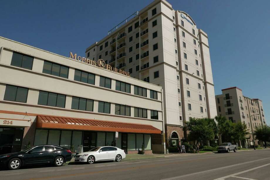 The area around the Morris Building at 214 Dwyer, left, the Wyndham La Cascada, middle, and the La Cascada Condominiums in downtown San Antonio was ordered to be swept clean of homeless people by police, according to internal memos and bulletins. City manager Sheryl Sculley, who lives in a luxury condominium here, allegedly gave the order. Photo: Billy Calzada, Staff / San Antonio Express-News / San Antonio Express-News