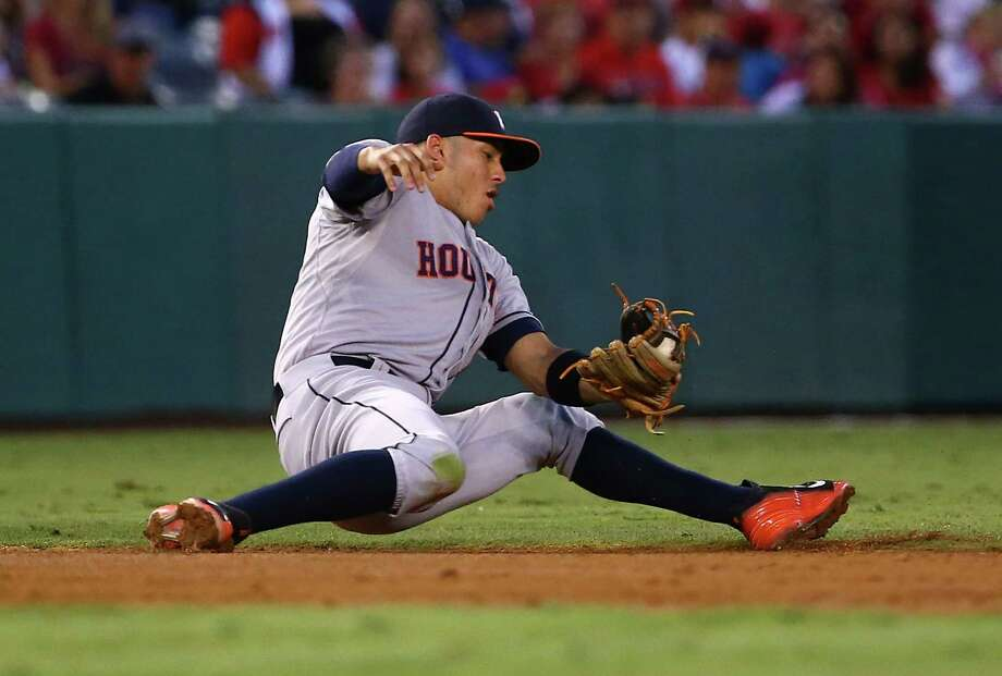 ANAHEIM, CA - SEPTEMBER 12:  Carlos Correa #1 of the Houston Astros fields a ground ball to short stop in the third inning against the Los Angeles Angels of Anaheim during the MLB game at Angel Stadium of Anaheim on September 12, 2015 in Anaheim, California.  (Photo by Victor Decolongon/Getty Images) Photo: Victor Decolongon, Stringer / 2015 Getty Images