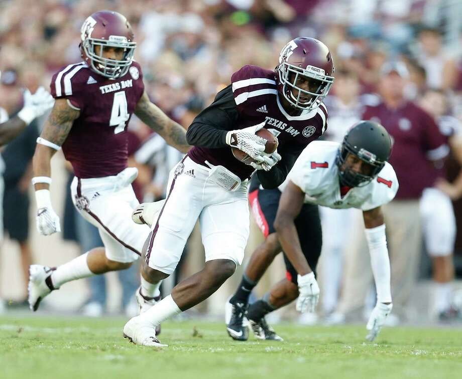 De'Vante Harris completes Texas A&M's 28-point first-quarter blitz Saturday night by intercepting a pass and returning it 40 yards for a touchdown at Kyle Field. Photo: Karen Warren, Staff / © 2015 Houston Chronicle