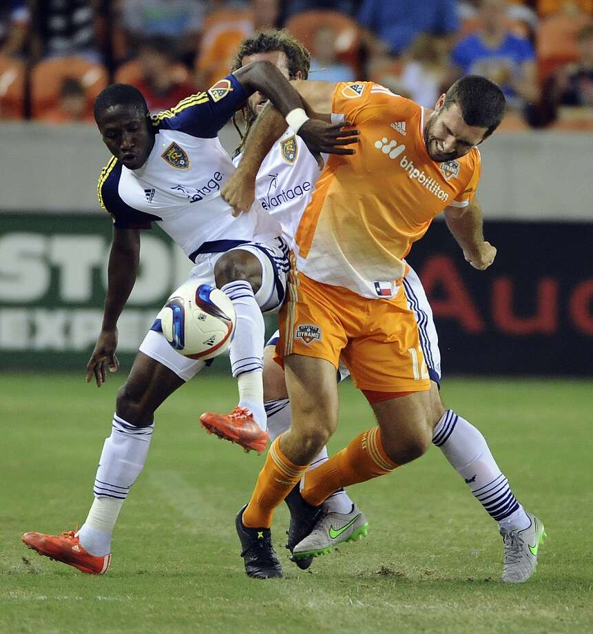 Houston Dynamo midfielder Brad Davis, right, and Real Salt Lake defender Demar Phillips, left, tangle during the first half of an MLS soccer game Saturday, Sept. 12, 2015, in Houston. (AP Photo/Eric Christian Smith) Photo: Eric Christian Smith, Associated Press / FR171023 AP