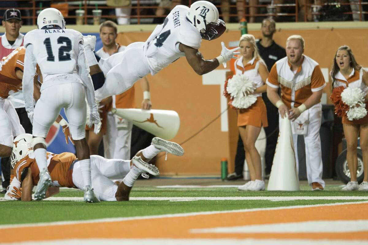 AUSTIN, TX - SEPTEMBER 12: Samuel Stewart #24 of the Rice Owls dives into the end zone for a 16-yard touchdown against the Texas Longhorns during the second quarter on September 12, 2015 at Darrell K Royal-Texas Memorial Stadium in Austin, Texas.