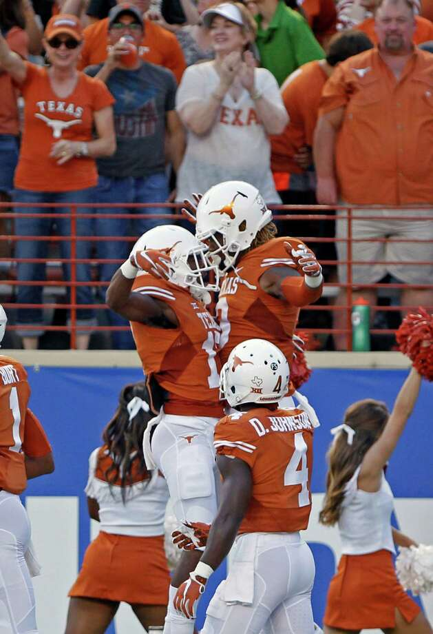 Texas wide receiver Armanti Foreman, right, celebrates his touchdown reception with teammate Ryan Newsome, left, during the first half of an NCAA college football game against Rice, Saturday, Sept. 12, 2015, in Austin, Texas. (AP Photo/Michael Thomas) Photo: Michael Thomas, Associated Press / FR65778 AP