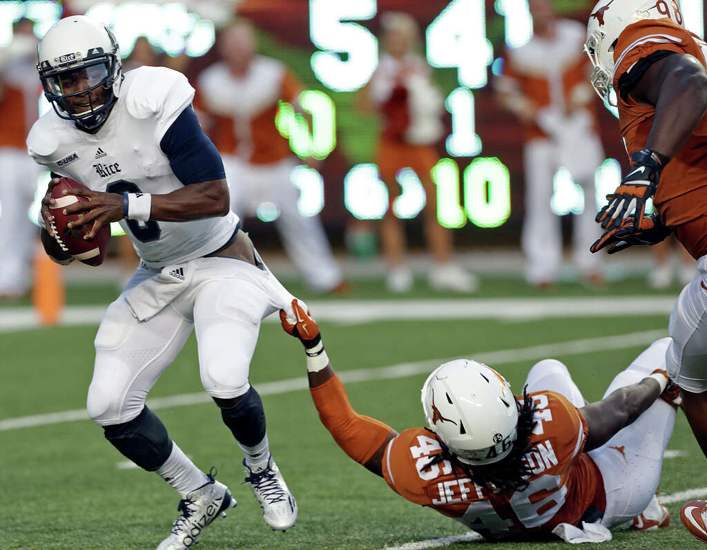 ut sells 1 8 million worth of alcohol in first wet football rice quarterback driphus jackson is slowed down by longhorn linebacker k jefferson as texas hosts the