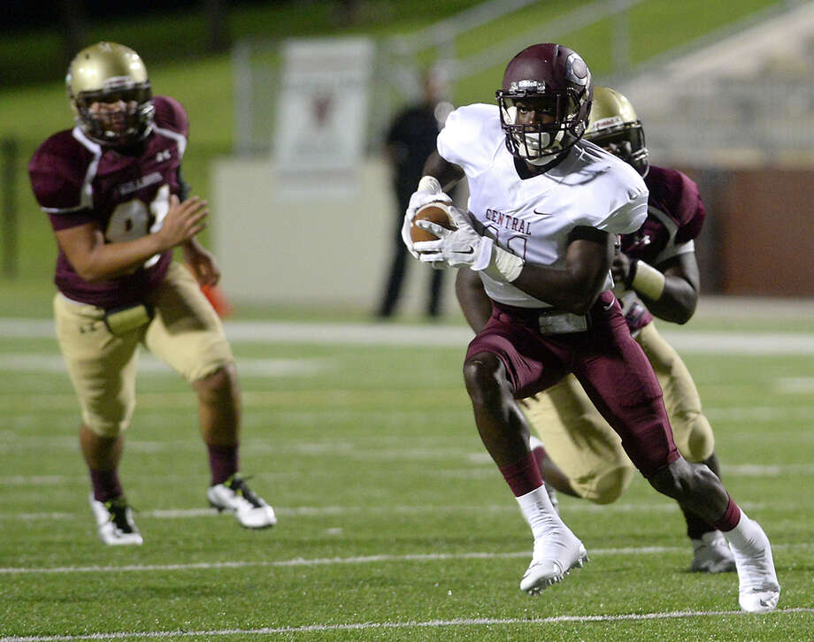 Central's Quentin Derry runs the ball as he finds a gap in the Summer Creek defense during their match-up of the Lone Star Classic at the Thomas Center Saturday. Photo taken Saturday, September 12, 2015 Photo by Kim Brent / Beaumont Enterprise