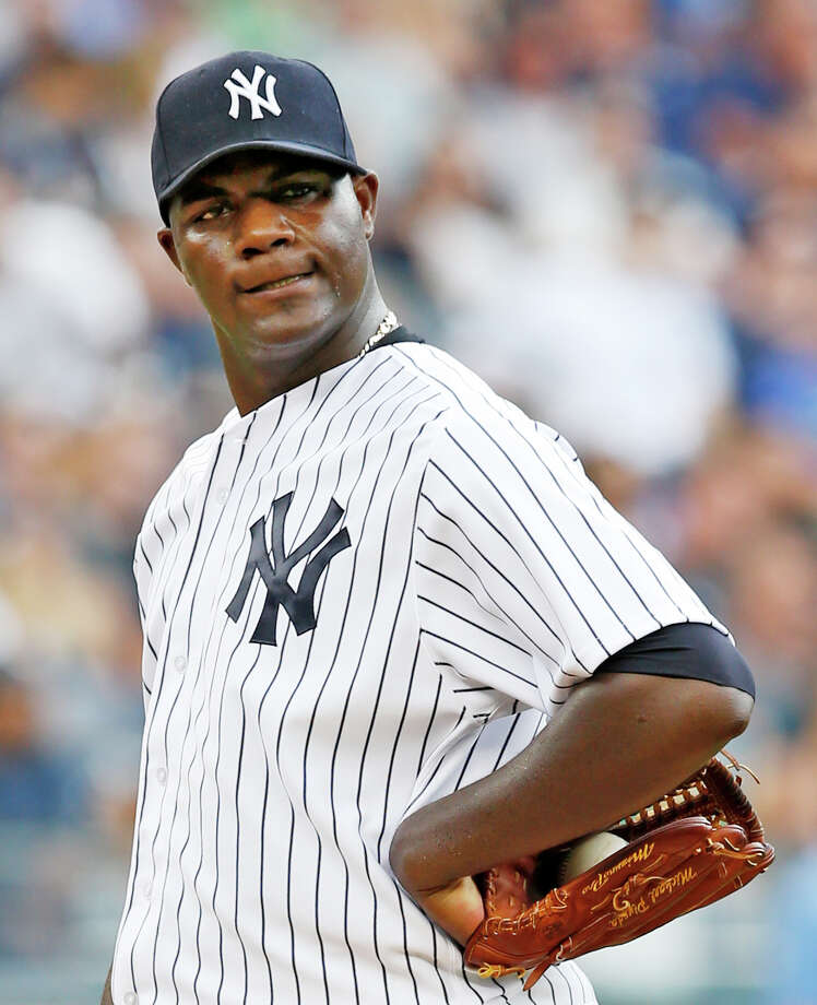 New York Yankees starting pitcher Michael Pineda reacts after allowing a fifth-inning,  two-run, home run to Toronto Blue Jays designated hitter Edwin Encarnacion in the first baseball game of a double header at Yankee Stadium in New York, Saturday, Sept. 12, 2015.  (AP Photo/Kathy Willens) ORG XMIT: NYY116 Photo: Kathy Willens / AP
