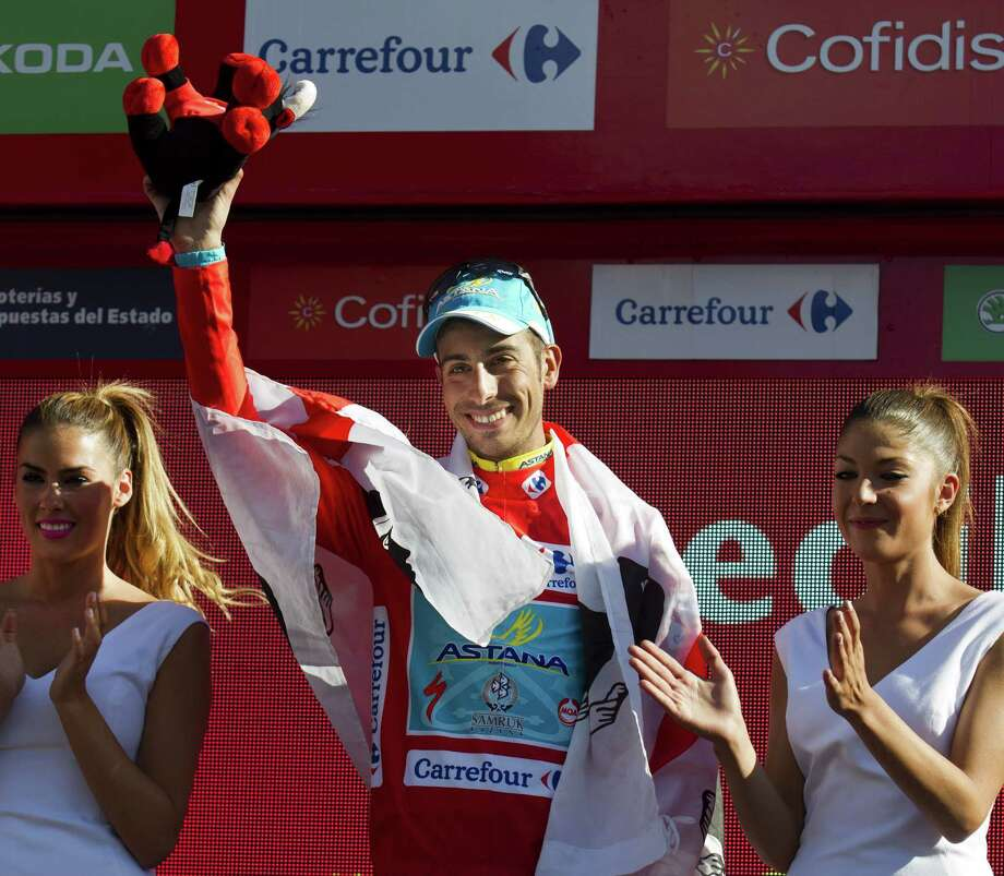 Astana's Italian cyclist Fabio Aru (C) celebrates his Red Jersey on the podium of the 20th Stage of the 2015 Vuelta Espana cycling tour, a 175,8km route between San Lorenzo del Escorial and Cercedilla on September 12, 2015.   AFP PHOTO/ JAIME REINAJAIME REINA/AFP/Getty Images ORG XMIT: - Photo: JAIME REINA / AFP