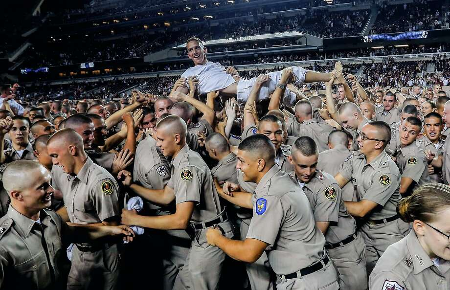A Texas A&M Yell Leader is carried off the field by the freshman Corps of Cadets during an NCAA college football game against Ball State, Saturday, Sept.12, 2015, in College Station, Texas. Photo: Bob Levey, Associated Press