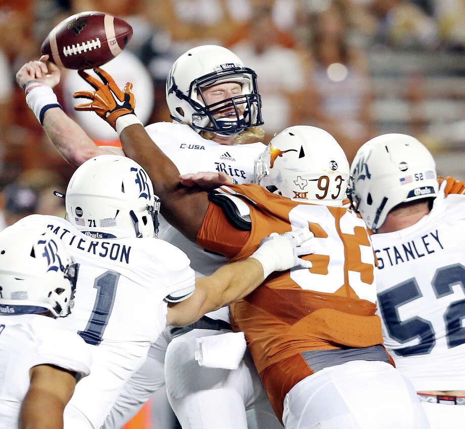 Rice Owls' Tyler Stehling passes under pressure from Texas Longhorns' Paul Boyette Jr. during second half action Saturday Sept. 12, 2015 at Royal-Memorial Stadium in Austin. Texas won 42-28. Photo: Edward A. Ornelas /San Antonio Express-News / © 2015 San Antonio Express-News