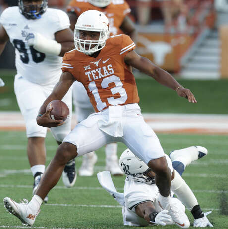 Horns quarterback Jerrod Heard evades tacklers as Texas hosts the Rice Owls at DKR Stadium in Austin on  September 12, 2015. Photo: Tom Reel / San Antonio Express-News