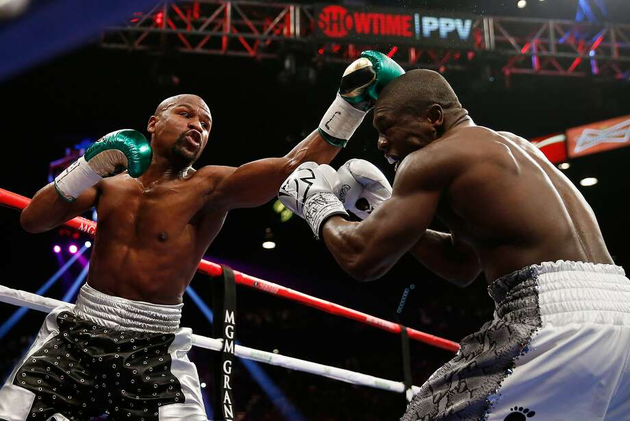 Floyd Mayweather Jr. throws a left at Andre Berto during their WBC/WBA welterweight title fight in Las Vegas. Photo: Ezra Shaw, Getty Images
