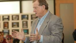"San Antonio billionaire B.J. ""Red"" McCombs visits with University of Texas at Austin business students at an event at the UT Red McCombs School of Business."