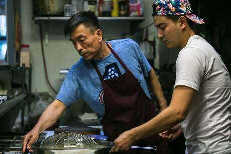 """Father and son Bahtiyar Tursun (left) and Zulpukar """"Carl"""" Bahtiyar work together in the kitchen every day at Uyghur Taamliri in S.F. Photo: Jen Fedrizzi, Special To The Chronicle"""