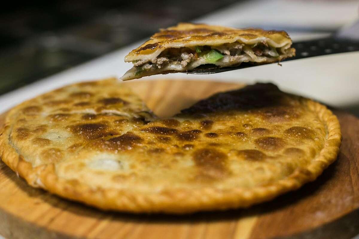 The inside of the Gosnan has lamb, veggies and a crisp bite from Uyghur Taamliri in San Francisco.