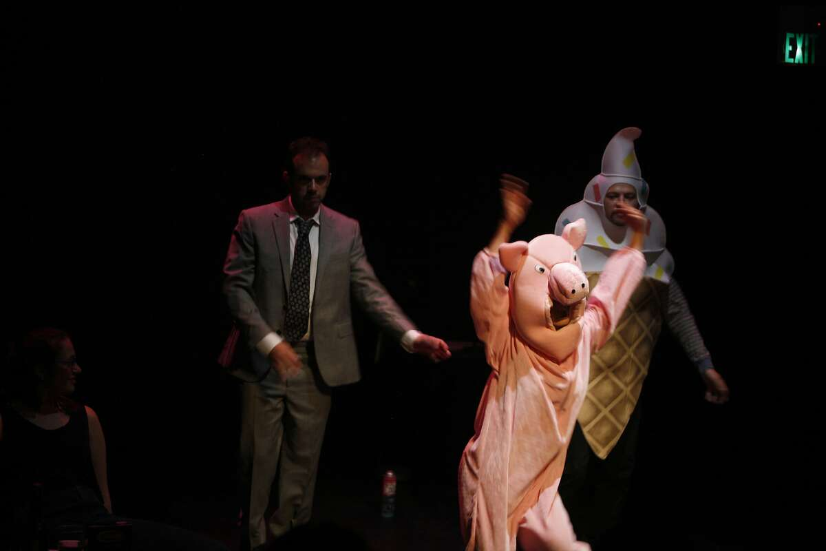 Appearing as a special guest, Arletta Anderson (pig), appear with (l to r) Rachel Resnik, Adam Smith and Fred Koluch in the production, Theatre Show, at the San Francisco Fringe Festival hosted at the Exit Theatre September 12, 2015.