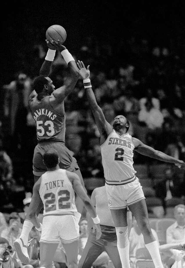 FILE - In this April 20, 1984, file photo, New Jersey Nets' Darryl Dawkins (53) towers over Philadelphia 76ers' Moses Malone (2) as he gets off a shot during first quarter NBA playoff action in Philadelphia. Malone, a three-time NBA MVP and one of basketball's most ferocious rebounders, died Sunday, Sept. 13, 2015, according to a The Philadelphia 76ers statement. He was 60. (AP Photo/Rusty Kennedy, File) ORG XMIT: NY111 Photo: Rusty Kennedy / AP