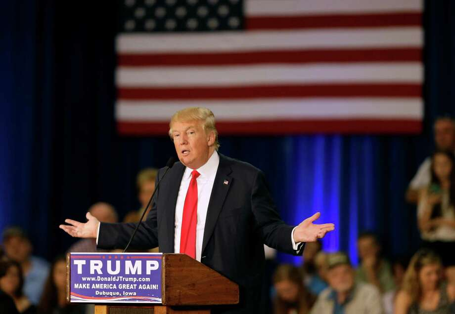 Republican presidential candidate Donald Trump speaks during a rally, Tuesday, Aug. 25, 2015, in Dubuque, Iowa. (AP Photo/Charlie Neibergall) Photo: Charlie Neibergall, STF / AP