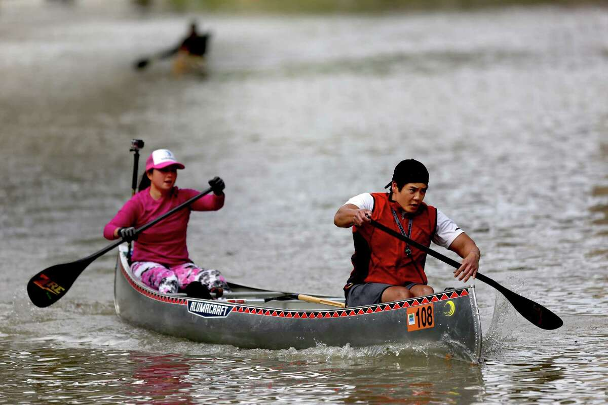 Paddlers Suzanne Pham and Hau Pham, of St. Arnold Brewing Company, in the Corporate Cup Coed category, in the 43rd Annual Buffalo Bayou Regatta, a 15-mile American Canoe Association (ACA) sanctioned race, along the scenic Buffalo Bayou Saturday, March 7, 2015, in Houston, Texas. Pham and Pham placed second with a time of 02:07:50.52. ( Gary Coronado / Houston Chronicle )