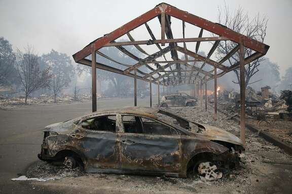 Burnt out cars and destroyed buildings in the wake of the Valley Fire in Middletown, California, on Sunday, Sept. 13, 2015.