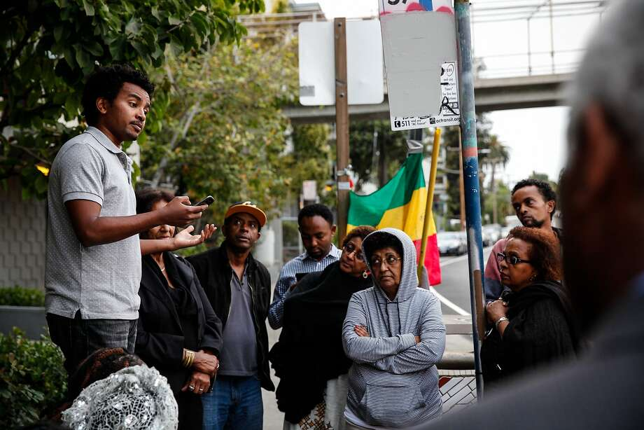 "Ash Gichamo speaks at a candlelight vigil in the spot where Yonas Alehegne, an Ethiopian immigrant, was shot and killed by an Oakland police officer in August, in Oakland, Calif., on Sunday, September 13, 2015.  Gichamo didn't know Alehegne but says there's a lot of Ethiopians in that neighborhood.  ""It could have been me,"" he said. Photo: Sarah Rice, Special To The Chronicle"