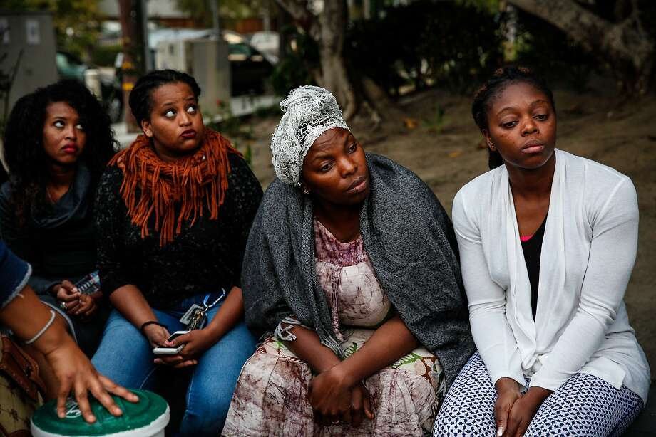 From right, Annick Seri, Nadege Nadege, Meheret Anulo, and Pineal Anulo listen at a candlelight vigil for Yonas Alehegne, an Ethiopian immigrant who was shot and killed by an Oakland police officer in August, in Oakland, Calif., on Sunday, September 13, 2015. Photo: Sarah Rice, Special To The Chronicle
