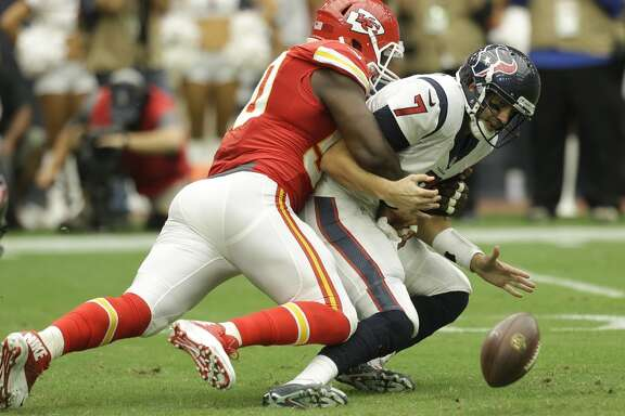 Houston Texans quarterback Brian Hoyer (7) fumbles as he is sacked by Kansas City Chiefs outside linebacker Justin Houston (50) during the second quarter of an NFL football game at NRG Stadium on Sunday, Sept. 13, 2015, in Houston. ( Brett Coomer / Houston Chronicle )