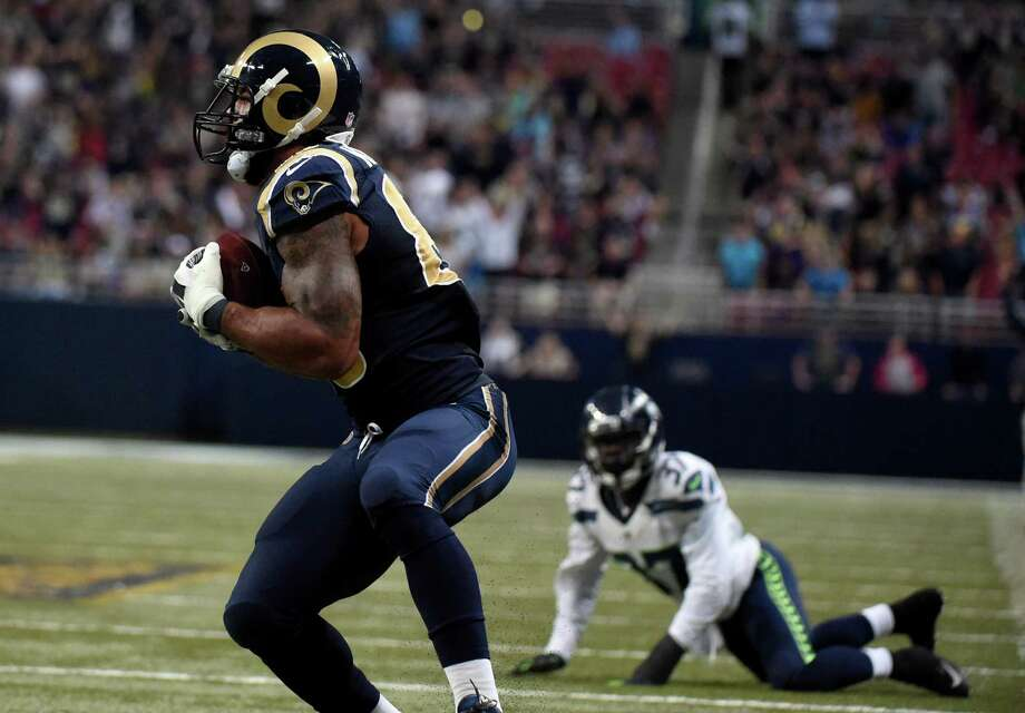St. Louis Rams tight end Lance Kendricks, left, catches a 37-yard pass for a touchdown as Seattle Seahawks free safety Dion Bailey, right, watches during the fourth quarter of an NFL football game Sunday, Sept. 13, 2015, in St. Louis. (AP Photo/L.G. Patterson) Photo: L.G. Patterson, Seattlepi.com / FR23535 AP