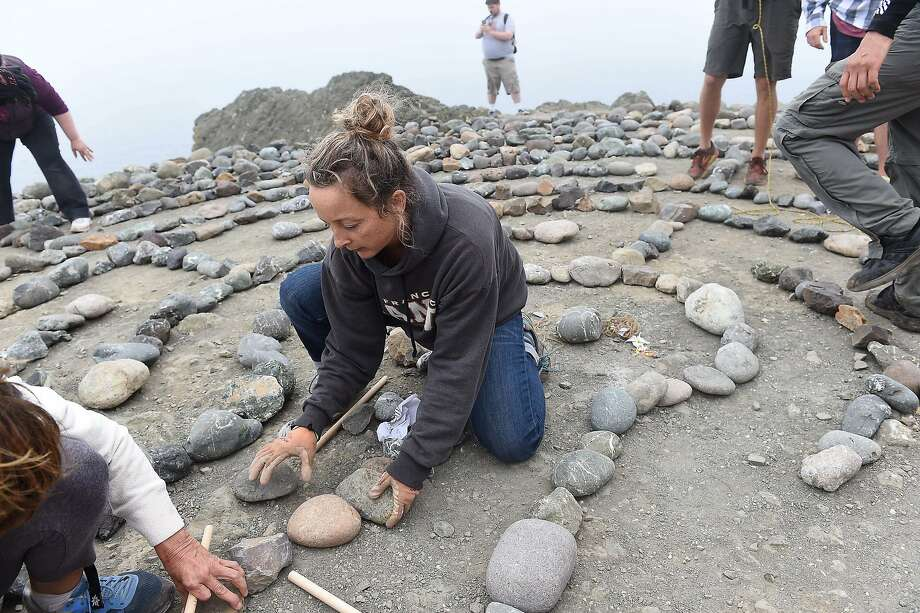 Colleen Yerge (caretaker of Lands End Labyrinth) is joined by many in rebuilding the labyrinth at Lands End in San Francisco on September 13, 2015. The labyrinth was destroyed in August. Photo: Susana Bates, Special To The Chronicle