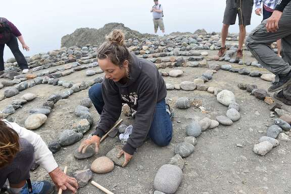 Colleen Yerge (caretaker of Lands End Labyrinth) is joined by many in rebuilding the labyrinth at Lands End in San Francisco on September 13, 2015. The labyrinth was destroyed in August.