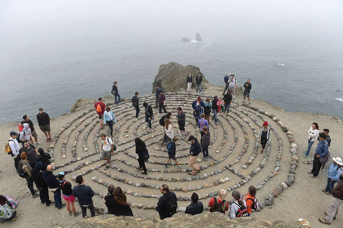 People walk the labyrinth after it was rebuilt at Lands End in San Francisco on September 13, 2015. The labyrinth was destroyed in August.