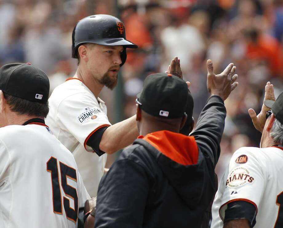 San Francisco Giants Mike Leake is greeted at the dugout after hitting a three run homer against the San Diego Padres during the second inning of a baseball game, Sunday, Sept. 13, 2015, in San Francisco. (AP Photo/George Nikitin) Photo: George Nikitin, Associated Press