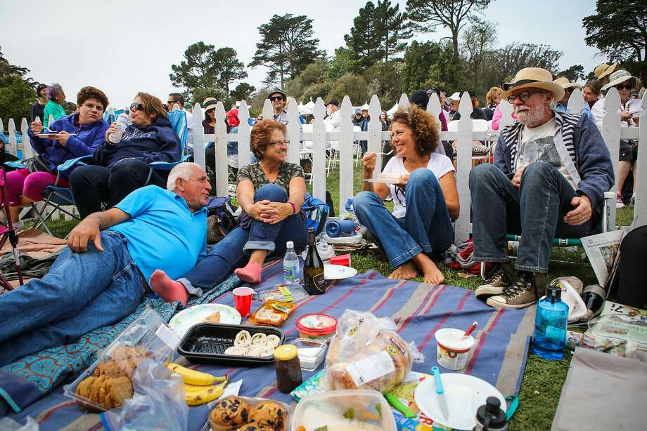 Andrei Bargaoanu (left), Fabienne Bargaoanu, Arzu Orgad and Brad Justice enjoy a picnic during the 42nd Opera in the Park at Sharon Meadow in Golden Gate Park. Photo: Gabrielle Lurie, Special To The Chronicle