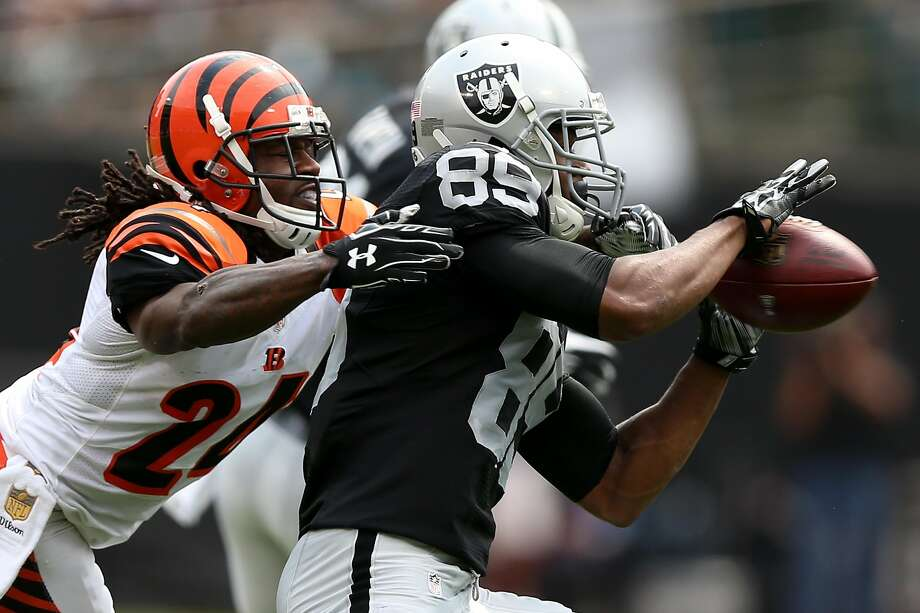 "Adam ""Pacman"" Jones defends a pass to Raiders' rookie receiver Amari Cooper. Jones later smacked Copper in the head and drew a $35,000 fine from the NFL. Photo: Ezra Shaw, Getty Images"