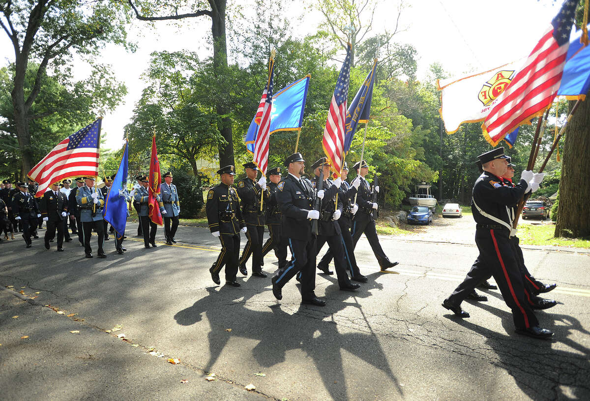 Police and fire honor guards from across Fairfield County march down Scribner Avenue to St. Matthew Church for the annual Diocesan Blue Mass in Norwalk, Conn. on Sunday, September 13, 2015.