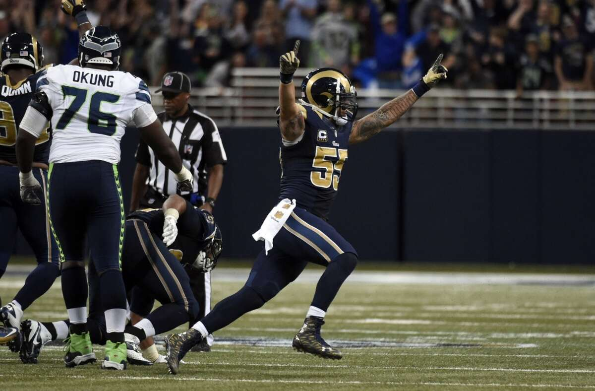 St. Louis Rams linebacker James Laurinaitis celebrates following the final play during overtime of an NFL football game against the Seattle Seahawks Sunday, Sept. 13, 2015, in St. Louis. The Rams won 34-31. (AP Photo/L.G. Patterson)