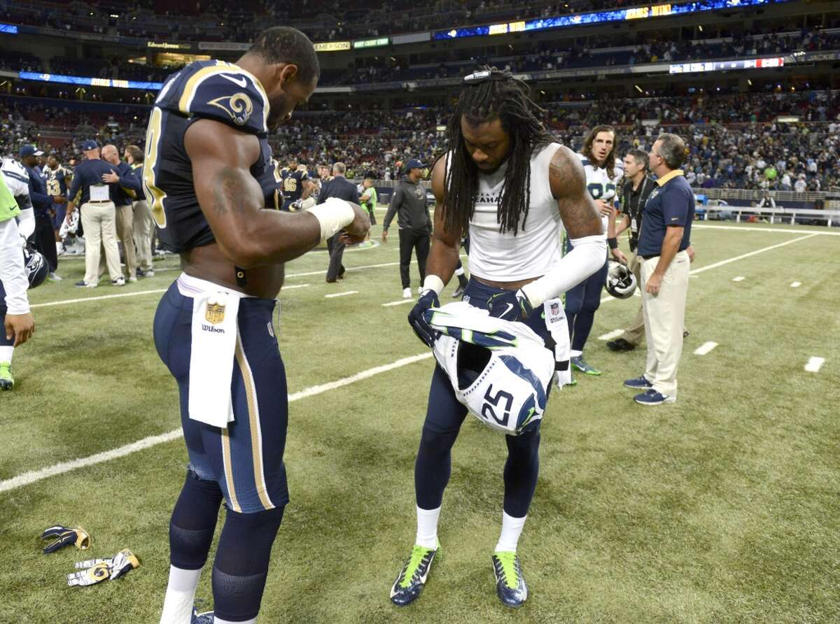 St. Louis Rams wide receiver Kenny Britt, left, and Seattle Seahawks cornerback Richard Sherman exchange jerseys following an NFL football game Sunday, Sept. 13, 2015, in St. Louis. The Rams won 34-31. (AP Photo/L.G. Patterson)