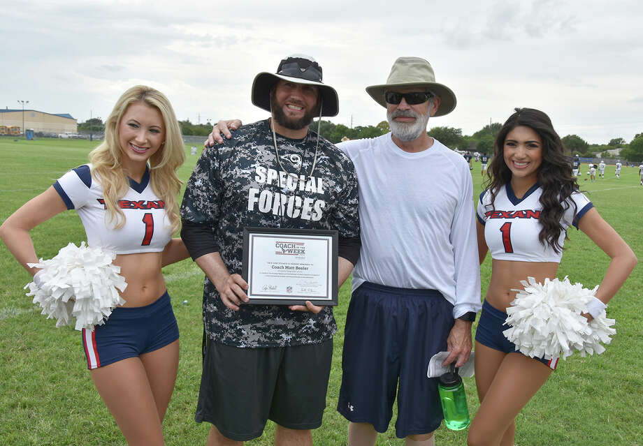 Cy Ridge assistant football coach Matthew Beeler (second from left) donated 63 percent of his liver to fellow assistant John McWilllams (right), helping to preserve the latter's health.