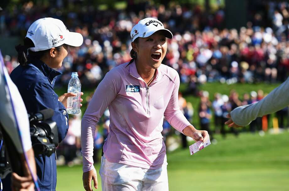 Lydia Ko seemingly surprises herself by winning her first major at the Evian Championship. Photo: Stuart Franklin, Getty Images