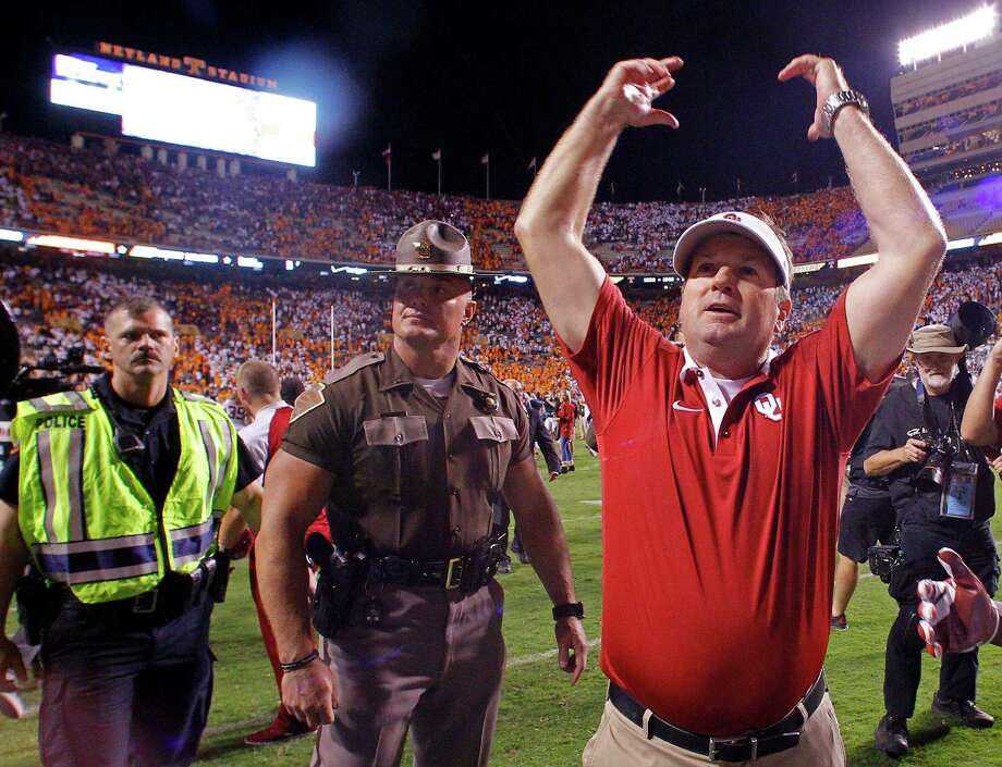 Oklahoma head coach Bob Stoops celebrates after defeating Tennessee 31-24 in double overtime of an NCAA college football game Saturday, Sept. 12, 2015 in Knoxville, Tenn. (AP Photo/Wade Payne) Photo: Wade Payne, FRE / Associated Press / FR23601 AP