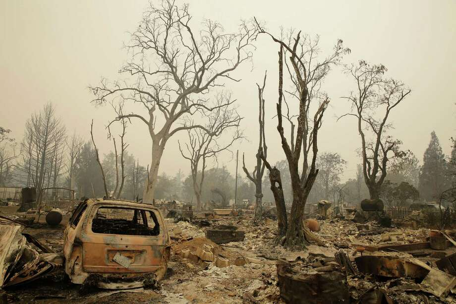 A burned vehicle remains among a number of homes destroyed by fire Sunday, Sept. 13, 2015, in Middletown, Calif. Two of California�s fastest-burning wildfires in decades overtook at several Northern California towns, destroying over a hundred homes and sending residents fleeing Sunday.SFGate.com story: 'Incredibly fast' Valley Fire destroys hundreds of buildings Photo: Eric Risberg, AP / AP