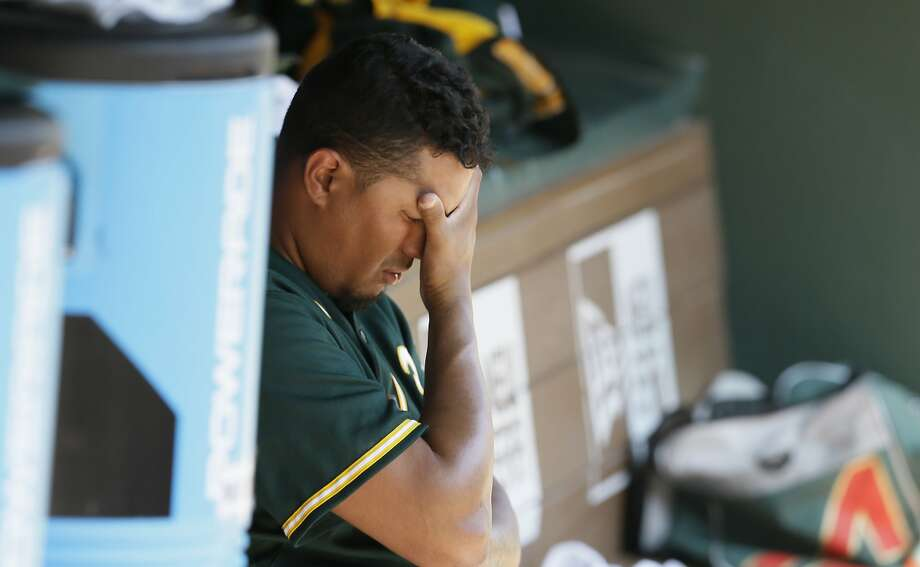 A's starter Felix Doubront is alone with his thoughts after being pulled in the fifth inning in Arlington, Texas. Photo: LM Otero, Associated Press
