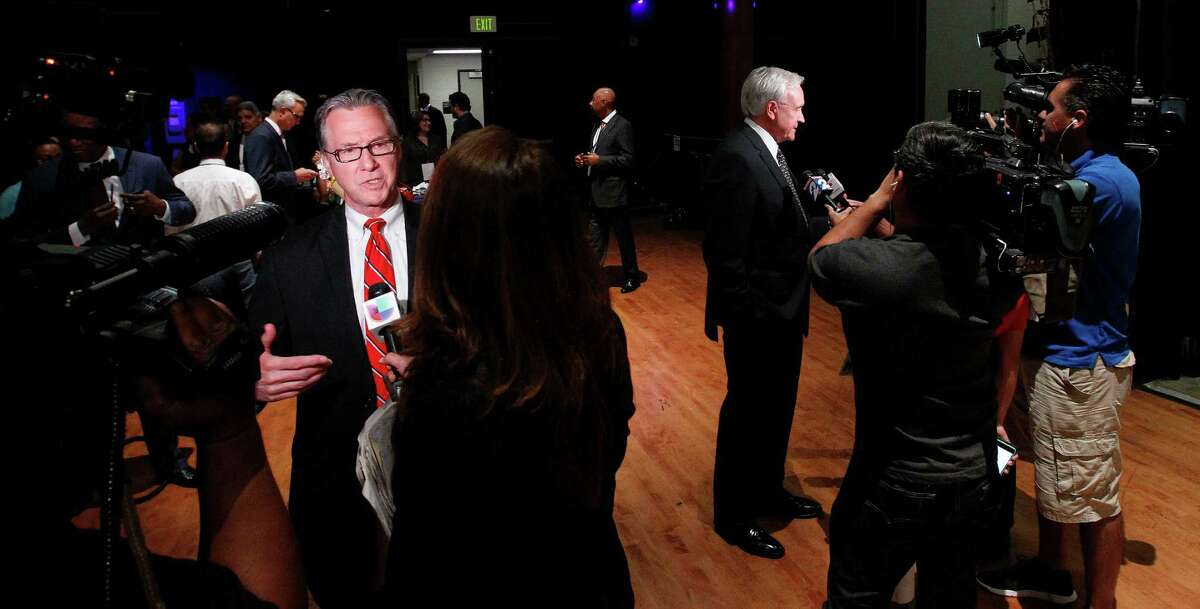 Steve Costello, left, and Bill King were among the mayoral candidates with microphones and cameras in their faces after last week's debate at the Hobby Center. Both candidates are courting conservative Houston voters as they bid to replace Annise Parker.