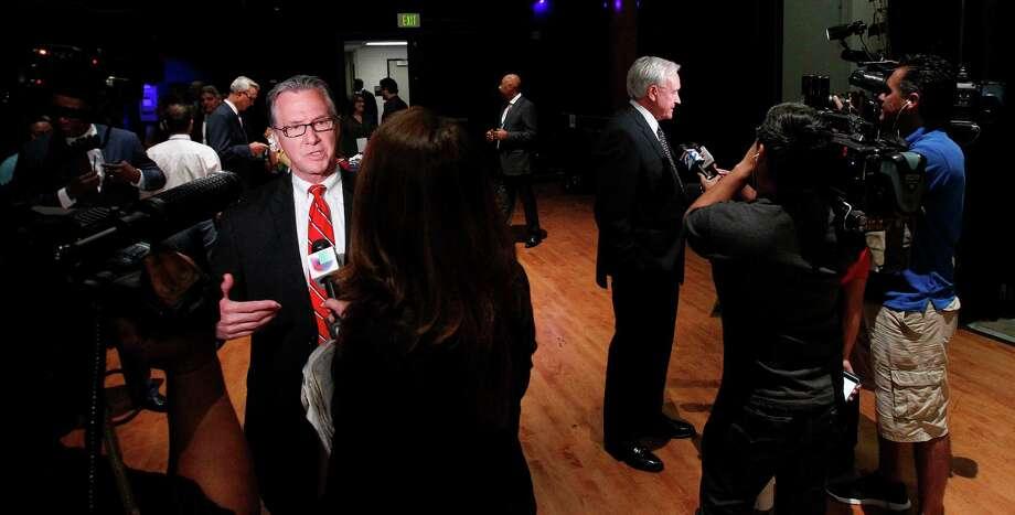 Steve Costello, left, is interviewed after a debate in September. Photo: Karen Warren, Staff / © 2015 Houston Chronicle