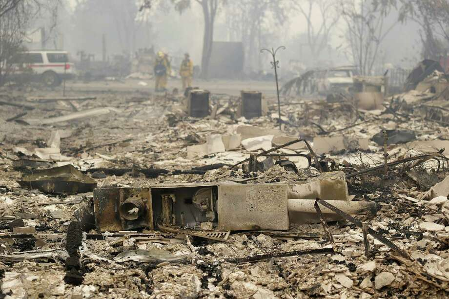 The remains of several homes destroyed by fire are seen Sunday, Sept. 13, 2015, in Middletown, Calif. California Gov. Jerry Brown has declared a state of emergency in Lake and Napa Counties after a wildfire charred more than 60 square miles within 12 hours, prompting thousands to flee their homes. Brown said Sunday the declaration will expedite debris removal and waive fees to people who need to replace official documents lost in the fire.  The blaze, about 100 miles north of San Francisco, has destroyed an unconfirmed number of homes and other buildings and damaged highways and other infrastructure.(AP Photo/Eric Risberg) Photo: Eric Risberg, STF / AP