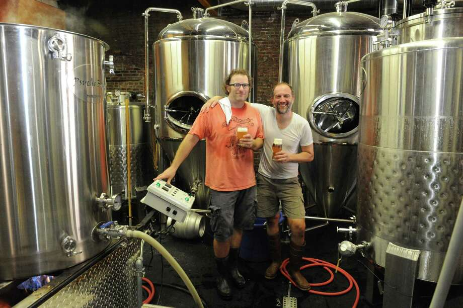 Kevin Mullen, left, with co-brewer Jamie Caligure at Rare Form Brewery on Friday Sept. 11, 2015 in Troy, N.Y.  (Michael P. Farrell/Times Union) Photo: Michael P. Farrell / 00033335A