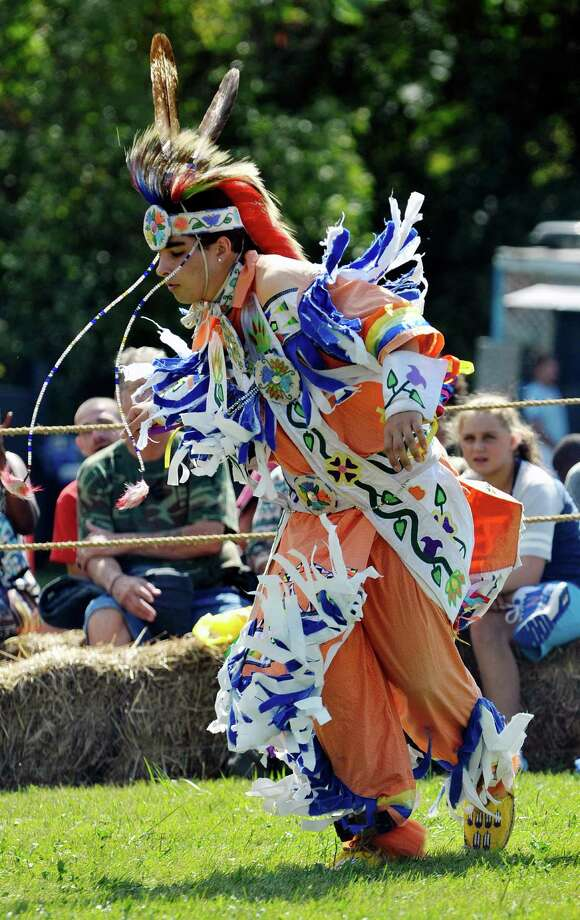 Skye Pasaghesic, 16, from Glens Falls and a member of the Ojibwe and Abenaki Tribes dances the grass dance at the 6th Annual Gathering of the Tribes at Browns Farm on Sunday, Sept. 13, 2015, in East Greenbush, N.Y.  (Paul Buckowski / Times Union) Photo: PAUL BUCKOWSKI / 00033193A