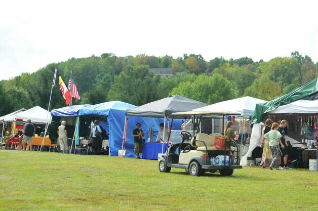 People look over the different vendor's booths at the 6th Annual Gathering of the Tribes at Browns Farm on Sunday, Sept. 13, 2015, in East Greenbush, N.Y.  (Paul Buckowski / Times Union) Photo: PAUL BUCKOWSKI / 00033193A
