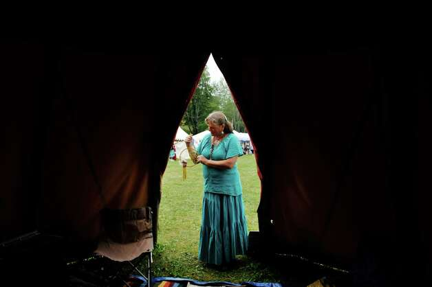 Zelda Hotaling of Castelton holds a dream catcher she made as she stands in the doorway of a teepee at the 6th Annual Gathering of the Tribes at Browns Farm on Sunday, Sept. 13, 2015, in East Greenbush, N.Y.  Hotaling is working on finishing a very large series of sacred dream circles that will be on display at the St. Paul's Church in Castleton from December 15th through the 18th.  (Paul Buckowski / Times Union) Photo: PAUL BUCKOWSKI / 00033193A