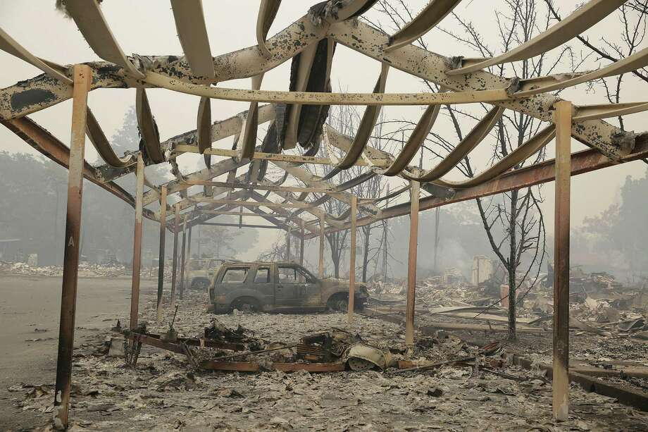 The frame of a carport stands out in the wildfire debris at an apartment complex in Middletown, Calif. Photo: Eric Risberg /Associated Press / AP